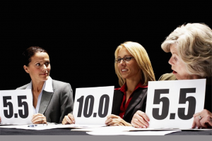 Ladies with score cards showing the use of decimals